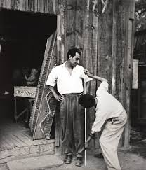 Man being measured for coffin
